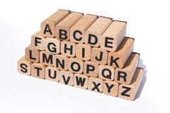 Alphabet letters on wooden cubes on white background Stock Photography