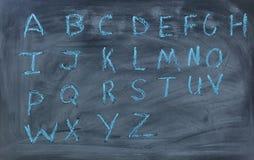 English alphabet letters written on chalk board Royalty Free Stock Photos