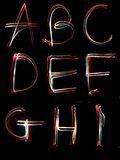 Alphabet light neon writing long exposure Royalty Free Stock Photography