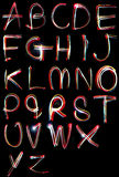 Alphabet light neon writing long exposure Royalty Free Stock Photo