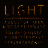 Alphabet of lights. Alphabet of gold lights on dark background Royalty Free Stock Photo