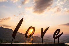 Alphabet `love`. And sunset background Royalty Free Stock Photo