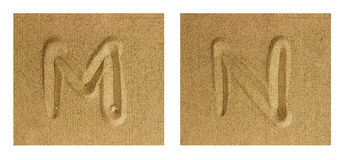 Alphabet M-N on sand Stock Photos