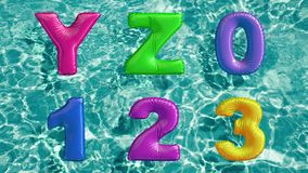 Alphabet made of shaped inflatable swim ring floating in a refreshing blue swimming pool. 3d rendering Stock Photo