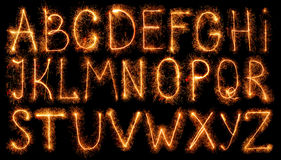 Alphabet made of sparklers isolated on black Stock Photo