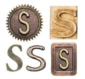 Alphabet. Made of wood and metal. Letter S royalty free stock photography