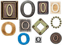 Alphabet. Made of wood, metal, plasticine. Letter O Royalty Free Stock Photography
