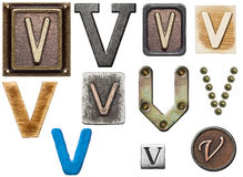 Alphabet. Made of wood, metal, plasticine. Letter V stock photography