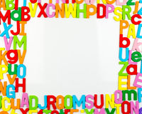 Alphabet magnets forming frame on whiteboard Royalty Free Stock Photography
