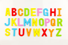 Alphabet magnets on whiteboard stock photos