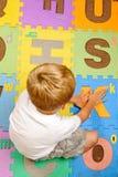 Alphabet mat cutout Stock Photo