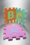 Alphabet Mat Puzzle Stock Images