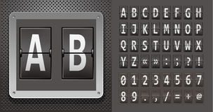 Alphabet of mechanical panel on metallic plate. Stock Photo