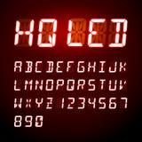 Alphabet numérique de LED sur le fond rouge Images libres de droits
