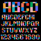 Alphabet and numbers. Made of plastic building blocks royalty free illustration