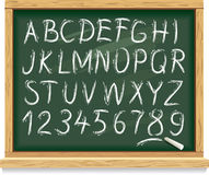 Alphabet and numbers on a blackboard Stock Images