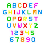 Alphabet and numbers colorful origami. Font on white Stock Photography