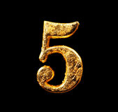 Alphabet and numbers in gold leaf. Isolated on black Royalty Free Stock Images