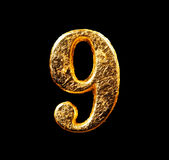 Alphabet and numbers in gold leaf. Isolated on black Royalty Free Stock Photos