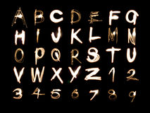 Alphabet_numbers_light_painting Stock Image