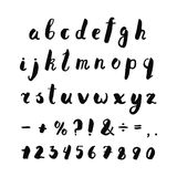 Alphabet, numbers and punctuation marks ink handwritten lettering. Hipster and vintage style. Stock Photography