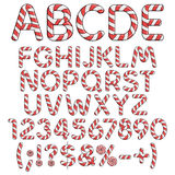 Alphabet, numbers and signs from red candies. Stock Photos