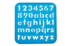 Alphabet and numbers stencil shapes. On a blue background Royalty Free Stock Photography