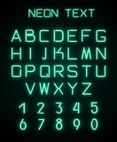 Alphabet and numerals created with neon light. English alphabet and numerals created with green neon light on black background. Template for advertising text Royalty Free Stock Photo