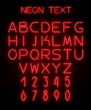 Alphabet and numerals created with neon light. English alphabet and numerals created with red neon light on black background. Template for advertising text Royalty Free Stock Photo