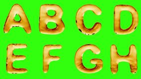 Alphabet from oil isolated on a green background. stock video