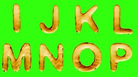 Alphabet from oil isolated on a green background. stock video footage