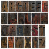 Alphabet in old dark wood type Stock Photography