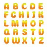 Alphabet with orange juice. Waves Royalty Free Stock Image