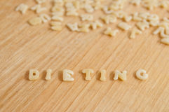 Alphabet pasta forming the text dieting Stock Image