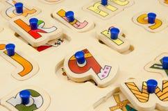 Alphabet peg puzzle. Close up of childs Alphabet peg puzzle royalty free stock photography