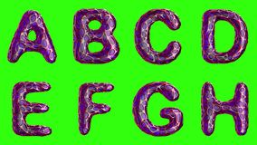 Alphabet from plastic with abstract holes isolated on a green background. A B C D E F G H . 4K