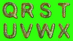 Alphabet from plastic with abstract holes isolated on a green background. Q R S T U V W X . 4K royalty free illustration