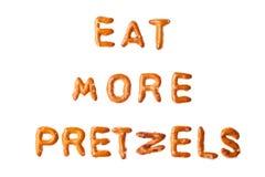 Alphabet pretzel words EAT MORE PRETZELS isolated. Words EAT MORE PRETZELS written, laid-out, with crispy alphabet letter pretzels isolated on white background Stock Image