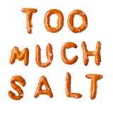 Alphabet pretzel words TOO MUCH SALT isolated Stock Photo