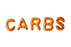 Alphabet pretzel written word CARBS isolated. Word CARBS written, laid-out, with crispy alphabet pretzels isolated on white background Royalty Free Stock Photography