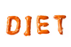 Alphabet pretzel written word DIET isolated. Word DIET written, laid-out, with crispy alphabet pretzels isolated on white background Royalty Free Stock Photos