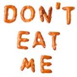 Alphabet pretzel written words DONT EAT ME isolated. Words DONT EAT ME written, laid-out, with crispy alphabet pretzels isolated on white background Stock Images