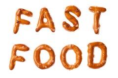 Alphabet pretzel written words FAST FOOD isolated. Words FAST FOOD written, laid-out, with crispy alphabet pretzels isolated on white background Stock Images