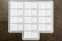 Alphabet printed in 3d on white square tiles. Set of uppercase a. Nd lowercase letters to make typographic tones made with a 3D printer. Maker activity fo royalty free stock photo