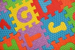 Alphabet puzzle background Stock Image