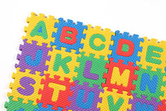 Alphabet puzzle isolated on white background. Multi colored alphabet puzzle on white background Royalty Free Stock Photos