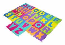 Alphabet puzzle isolated on white background Stock Photos