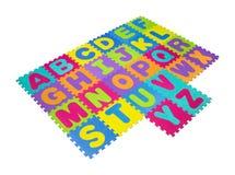 Alphabet puzzle isolated on white background Royalty Free Stock Images