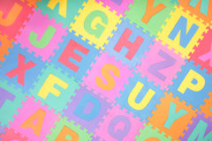 Alphabet puzzle letter tiles background. Colorful alphabet puzzle pieces and letter tiles background Stock Photos
