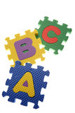 Alphabet puzzle pieces Royalty Free Stock Images